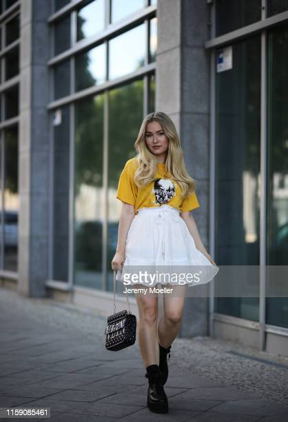 Sonny Loops wearing a Maison Valentino bag wrstbhvr shirt About You skirt and Asos boots on June 29 2019 in Berlin Germany