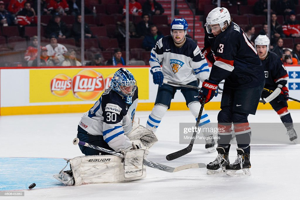 Sonny Milano #13 of Team United States is stopped by Ville Husso #30 of Team Finland during the 2015 IIHF World Junior Hockey Championship game at the Bell Centre on December 26, 2014 in Montreal, Quebec, Canada. Team United States defeated Team Finland 2-1 in a shootout.
