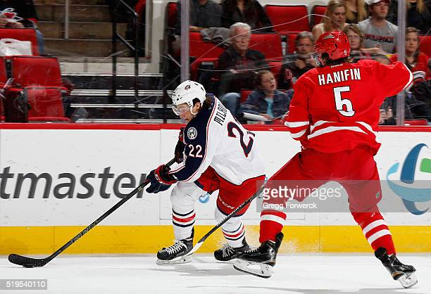 Sonny Milano of the Columbus Blue Jackets carries the puck as Noah Hanifin of the Carolina Hurricanes defends during an NHL game against the at PNC...