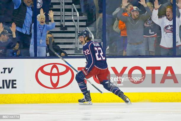 Sonny Milano of the Columbus Blue Jackets celebrates after scoring his first career NHL goal during the game against the New York Islanders on...