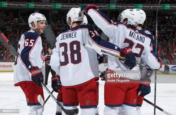 Sonny Milano of the Columbus Blue Jackets celebrates his first goal of the game against the Ottawa Senators with teammates Markus Nutivaara and Boone...