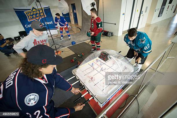 Sonny Milano of the Columbus Blue Jackets competes against Nikolay Goldobin of the San Jose Sharks in a game of table hockey at the 2015 NHLPA Rookie...