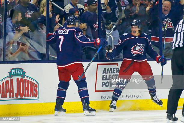 Sonny Milano of the Columbus Blue Jackets is congratulated by Jack Johnson of the Columbus Blue Jackets after scoring a goal during the first period...