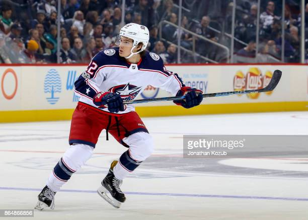 Sonny Milano of the Columbus Blue Jackets keeps an eye on the play during third period action against the Winnipeg Jets at the Bell MTS Place on...