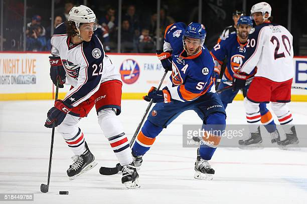 Sonny Milano of the Columbus Blue Jackets plays the puck in his first NHL game against Frans Nielsen of the New York Islanders at the Barclays Center...