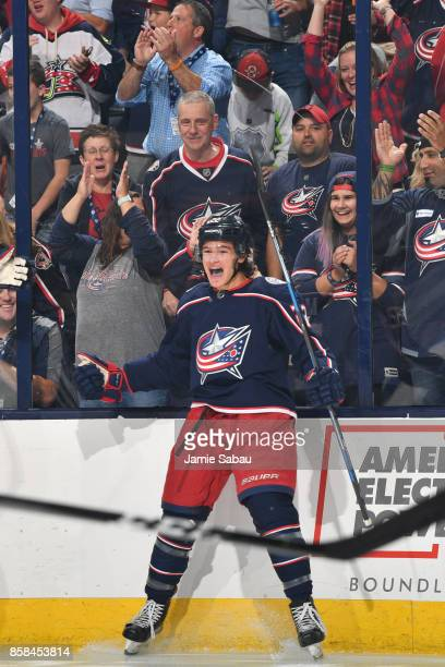 Sonny Milano of the Columbus Blue Jackets reacts after scoring a goal during the first period of a game against the New York Islanders on October 6...
