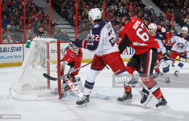 Sonny Milano of the Columbus Blue Jackets scores his first goal of the game against Mike Condon and Ben Harpur of the Ottawa Senators at Canadian...