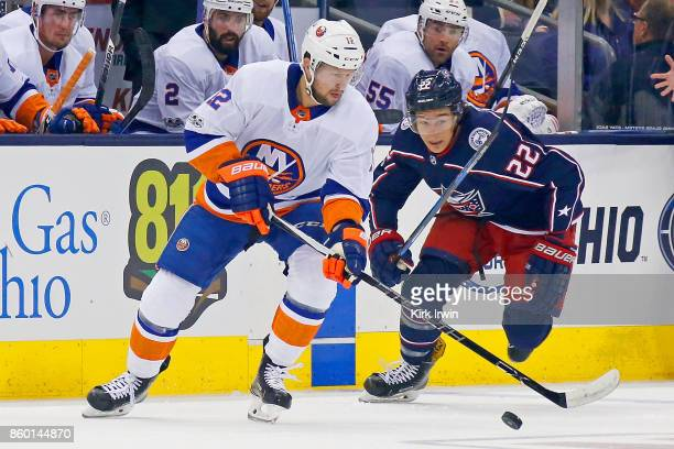 Sonny Milano of the Columbus Blue Jackets skates after Josh Bailey of the New York Islanders during the game on October 6 2017 at Nationwide Arena in...