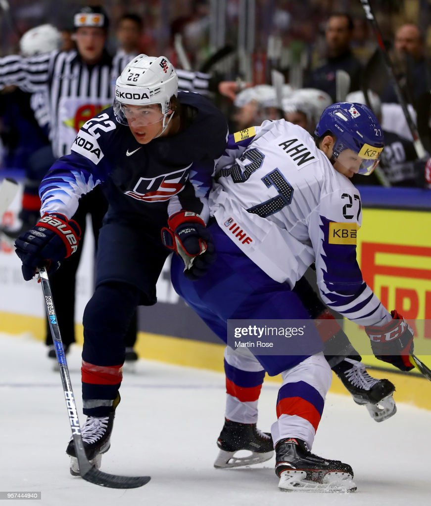 Sonny Milano (L) of United States and Jin Hui Ahn of Korea battle for the puck during the 2018 IIHF Ice Hockey World Championship group stage game between United States and Korea at Jyske Bank Boxen on May 11, 2018 in Herning, Denmark.