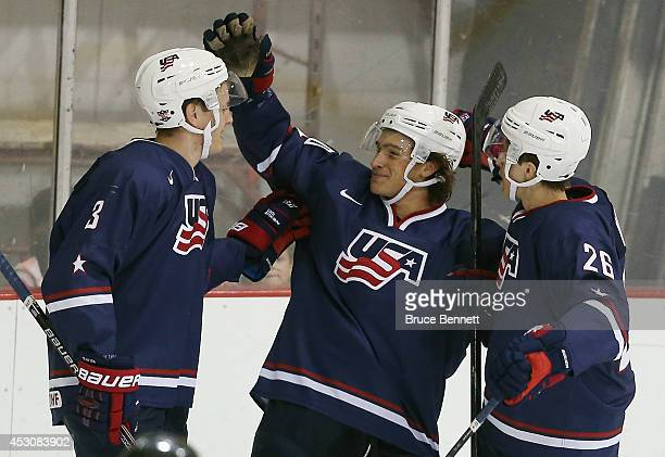 Sonny Milano of USA Blue celebrates his goal against USA White along with Mike Downing and Tommy Vannelli of USA Blue of USA White during the 2014...