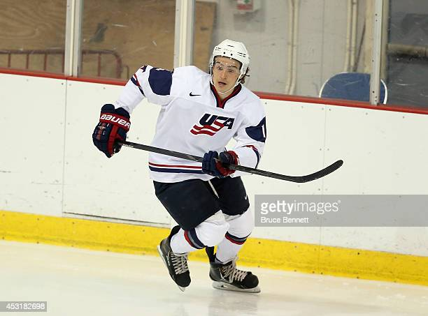 Sonny Milano of USA White skates against Team Finland during the 2014 USA Hockey Junior Evaluation Camp at the Lake Placid Olympic Center on August 4...