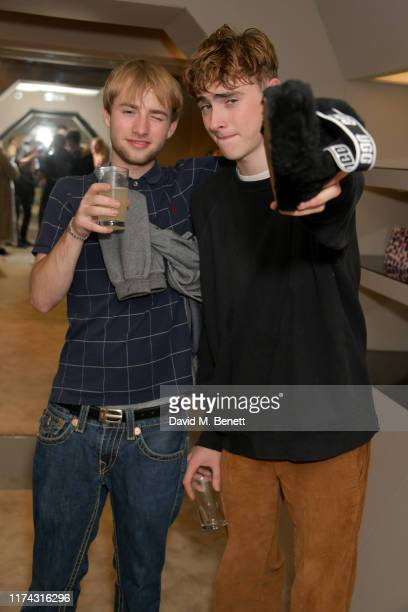 Sonny Starkey and Gene Gallagher attend the UGG Eckhaus Latta FW19 collection launch with performances from Mahalia Nick Grimshaw Betty Belle and...