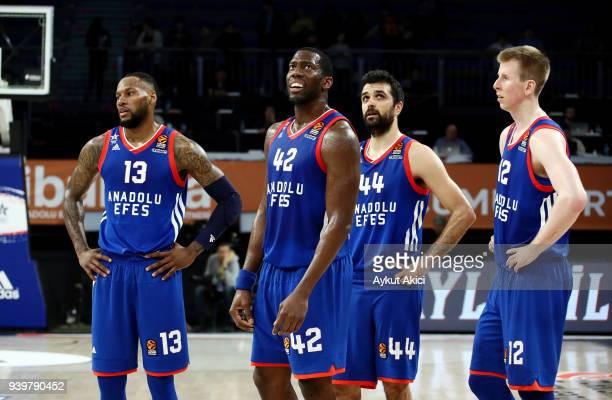 Sonny Weems, #13 of Anadolu Efes Istanbul, Bryant Dunston, #42 of Anadolu Efes Istanbul, Krunoslav Simon, #44 of Anadolu Efes Istanbul and Brock...