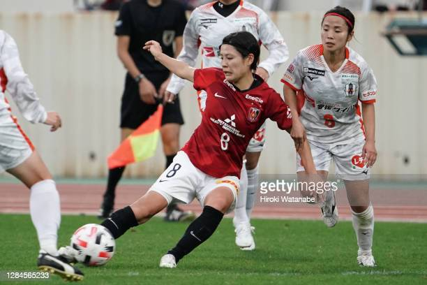 Sonoka Matsumoto of Ehime FC Ladies and Hikaru Naomoto of Urawa Red Diamonds compete for the ball during the Nadeshiko League match between Urawa Red...