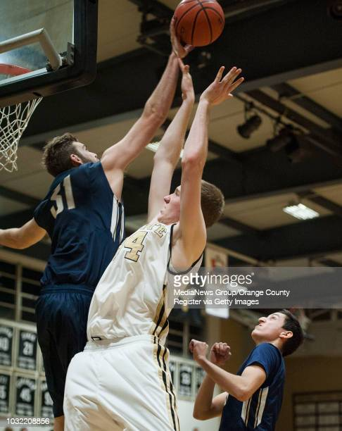 Sonora's Steven Murphy blocks a shot by Servite's Jacob Hughes as Ben Rico watches during the Raiders' 58-51 victory Tuesday night. ///ADDITIONAL...