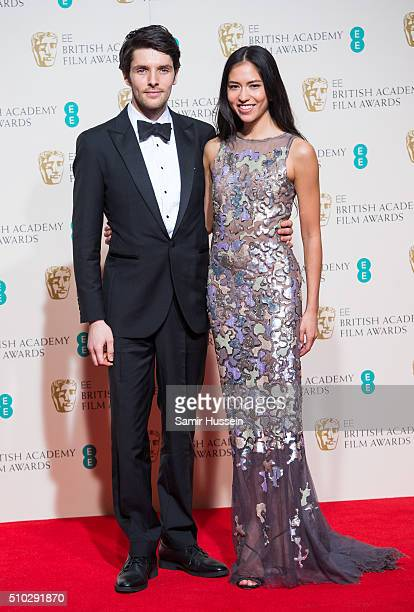 Sonoya Mizuno and Colin Morgan pose in the winners room at the EE British Academy Film Awards at The Royal Opera House on February 14 2016 in London...