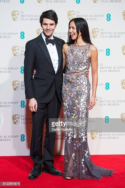 Sonoya Mizuno and Colin Morgan poses in the winners room at the EE British Academy Film Awards at The Royal Opera House on February 14 2016 in London...