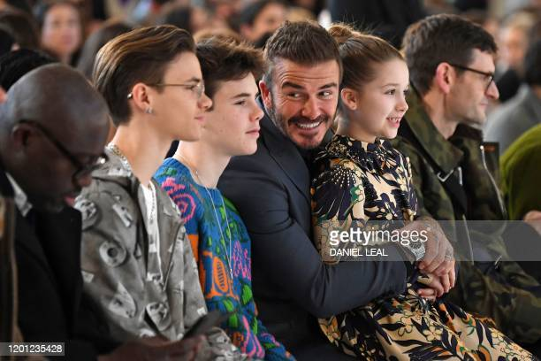 Sons of David and Victoria Beckham, Romeo Beckham and Cruz Beckham , David Beckham and his daughter Harper take their seats in the front row for the...