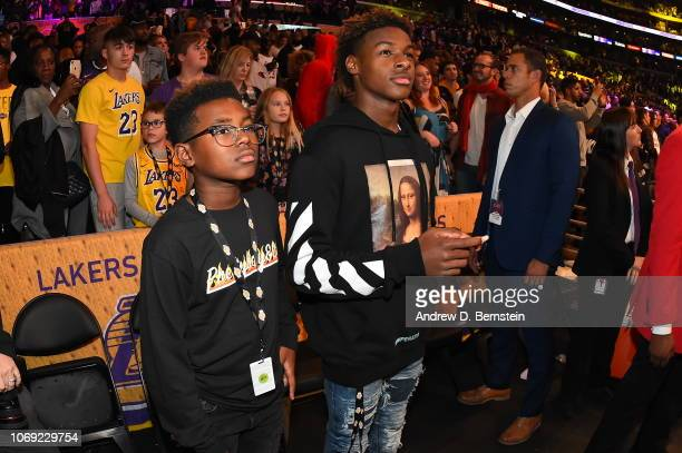 Sons of LeBron James of the Los Angeles Lakers LeBron James Jr and Bryce Maximus James during the game against the Utah Jazz on November 23 2018 at...