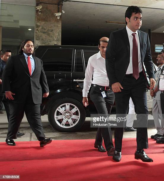 Sons of Reliance Chairman Mukesh Ambani Anant Ambani and Akshay Ambani arrive for Reliance AGM at Birla Matoshree Auditorium on June 12 2015 in...