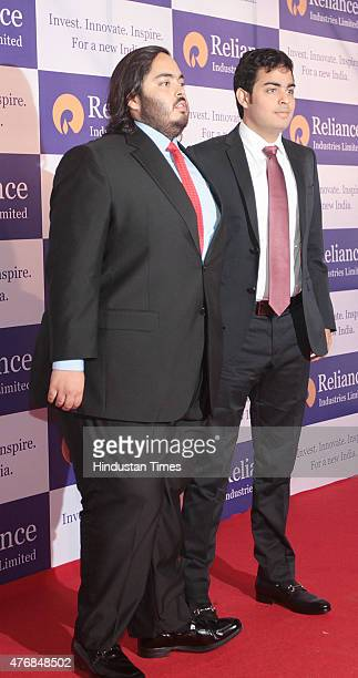 Sons of Reliance Chairman Mukesh Ambani Anant Ambani and Akshay Ambani during Reliance AGM at Birla Matoshree Auditorium on June 12 2015 in Mumbai...