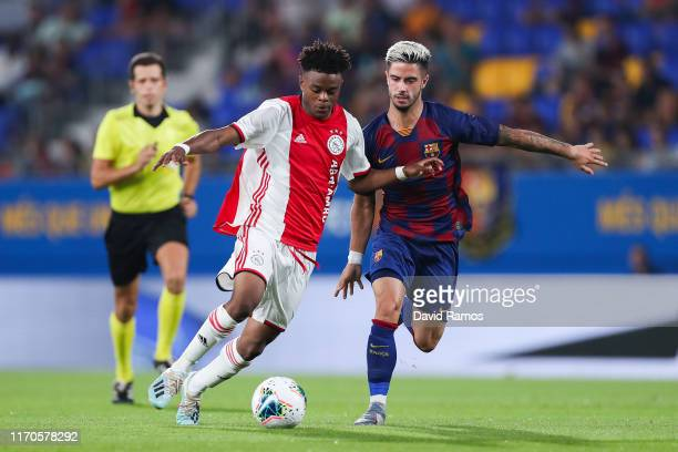 Sontje Hansen of Ajax U19 competes for the ball with Alvaro Sanz of FC Barcelona during their friendly match between FC Barcelona U19 and Ajax U19 at...