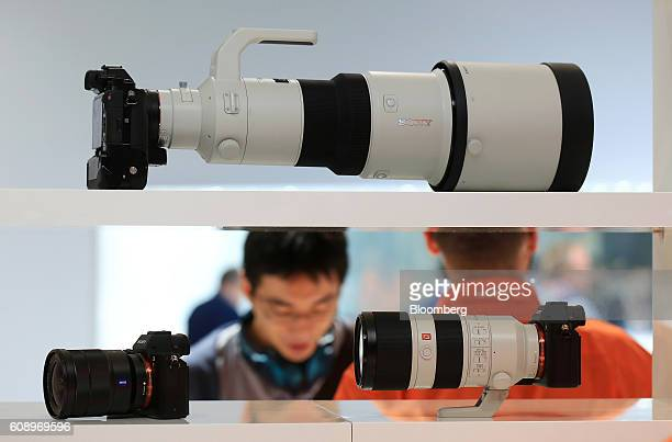 A Sony Alpha 7 camera manufactured by Sony Corp sits on display alongside Sony camera lenses during the Photokina photography trade fair in Cologne...