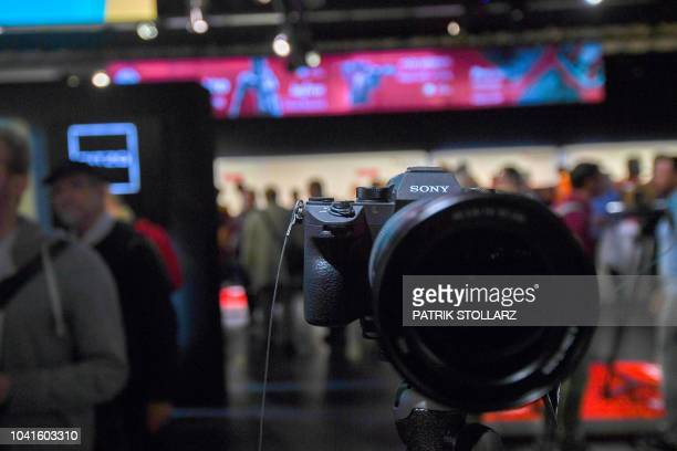 A Sony camera is seen at the Sony stand at the Photokina trade fair in Cologne western Germany on September 27 2018 The fair for the photographic and...