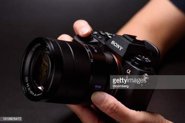 A Sony Corp Alpha a9 mirrorless digital camera mounted with an FE 2470mm f/4 ZA OSS standard zoom lens manufactured by Carl Zeiss AG is arranged for...