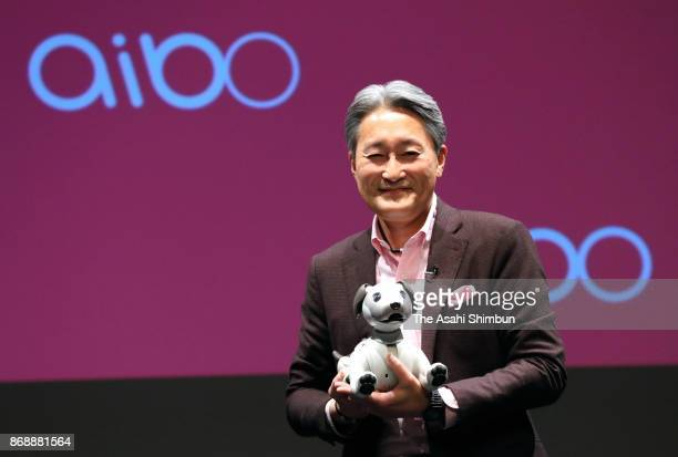 Sony Corp President and CEO Kazu Hirai unveils new robot pet 'aibo' during a press conference at the company headquarters on November 1 2017 in Tokyo...