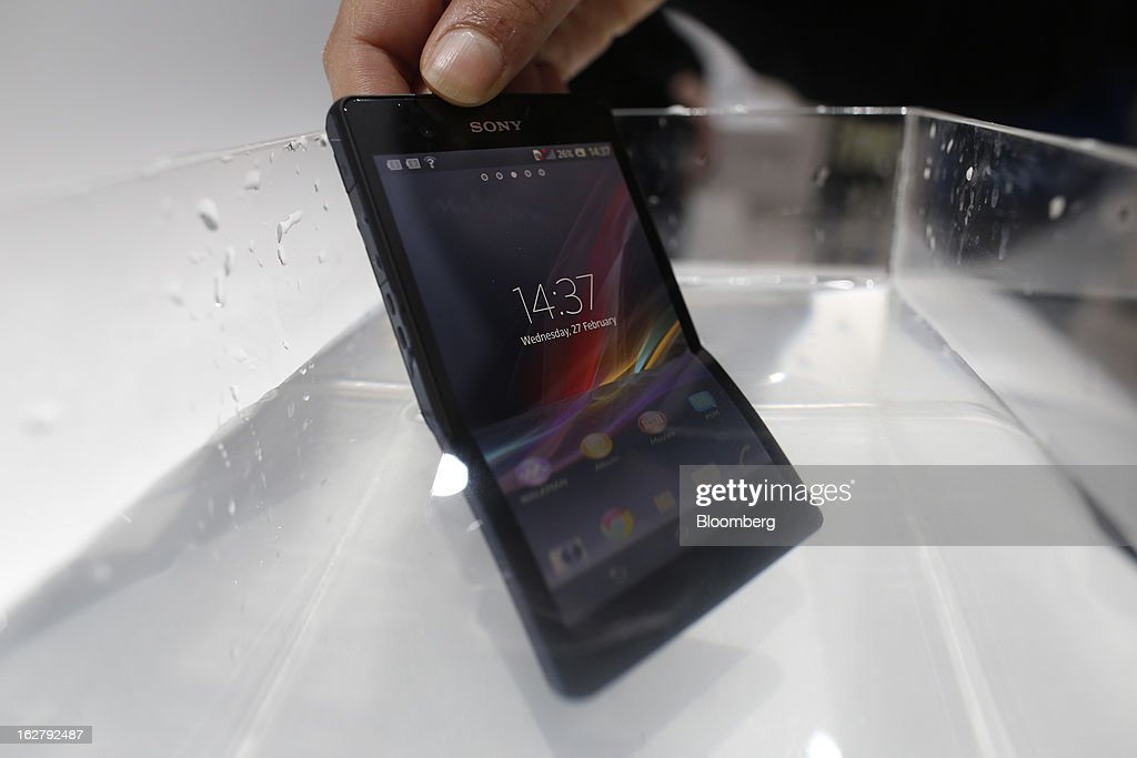 A Sony Corp. Xperia Z smartphone is held under water as an employee demonstrates the waterproofing capabilities of the unit at the Mobile World Congress in Barcelona, Spain, on Wednesday, Feb. 27, 2013. The Mobile World Congress, where 1,500 exhibitors converge to discuss the future of wireless communication, is a global showcase for the mobile technology industry and runs from Feb. 25 through Feb. 28. Photographer: Simon Dawson/Bloomberg via Getty Images