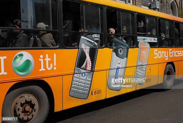 Sony Ericsson mobile phone advertisement on the side of a bus on Istanbul Street in central Tehran, 10th March 2007.