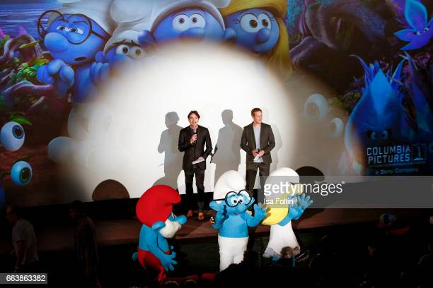 Sony Germany CEO Martin Bachmann and german presenter Jan Hahn at the stage presentation during the 'Die Schluempfe Das verlorene Dorf' premiere at...