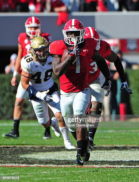 Sony Michel of the Georgia Bulldogs carries the ball against the Georgia Tech Yellow Jackets at Sanford Stadium on November 26 2016 in Athens Georgia