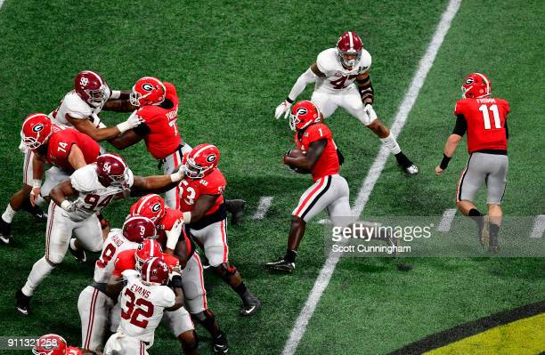 Sony Michel of the Georgia Bulldogs carries the ball against the Alabama Crimson Tide in the CFP National Championship presented by ATT at...