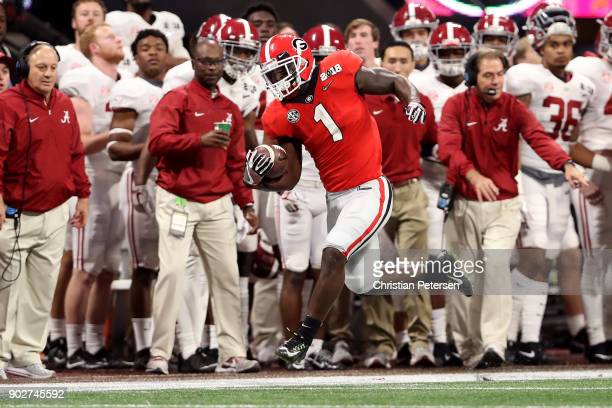 Sony Michel of the Georgia Bulldogs runs the ball down the sideline against the Alabama Crimson Tide during the first quarter in the CFP National...