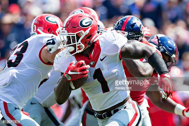 Sony Michel of the Georgia Bulldogs runs the ball during a game against the Mississippi Rebels at VaughtHemingway Stadium on September 24 2016 in...