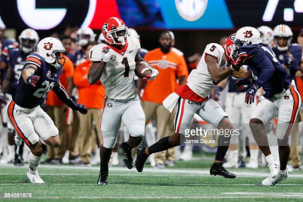 Sony Michel of the Georgia Bulldogs runs the ball during the first half against the Auburn Tigers in the SEC Championship at MercedesBenz Stadium on...