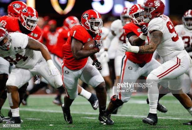 Sony Michel of the Georgia Bulldogs runs the ball during the first quarter against the Alabama Crimson Tide in the CFP National Championship...