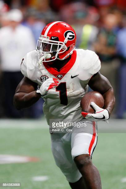 Sony Michel of the Georgia Bulldogs runs the ball during the second half against the Auburn Tigers in the SEC Championship at MercedesBenz Stadium on...