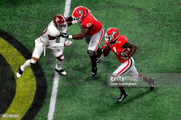 Sony Michel of the Georgia Bulldogs runs the ball during the second quarter against the Alabama Crimson Tide in the CFP National Championship...