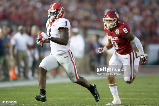 Sony Michel of the Georgia Bulldogs runs to the end zone for a touchdown tying the game 3131 in the 2018 College Football Playoff Semifinal Game at...