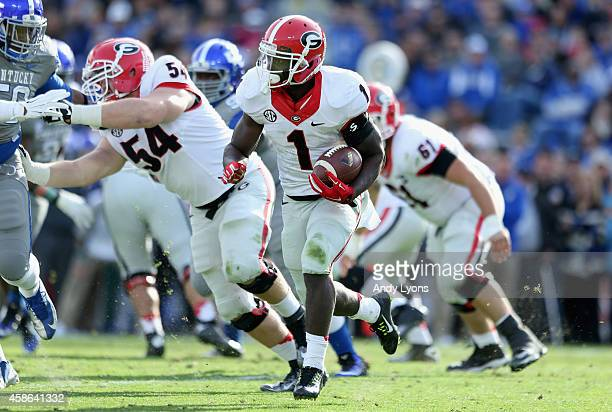 Sony Michel of the Georgia Bulldogs runs with the ball during the game against the Kentucky Wildcats at Commonwealth Stadium on November 8 2014 in...