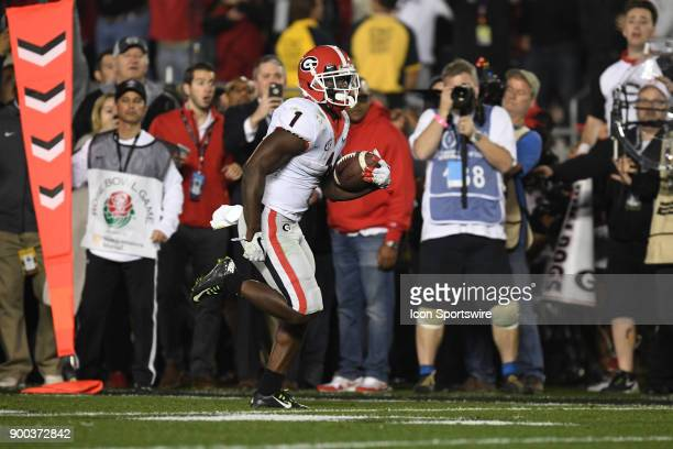 Sony Michel of the Georgia Bulldogs scores on a 27 yard touchdown run in the second overtime of the College Football Playoff Semifinal at the Rose...