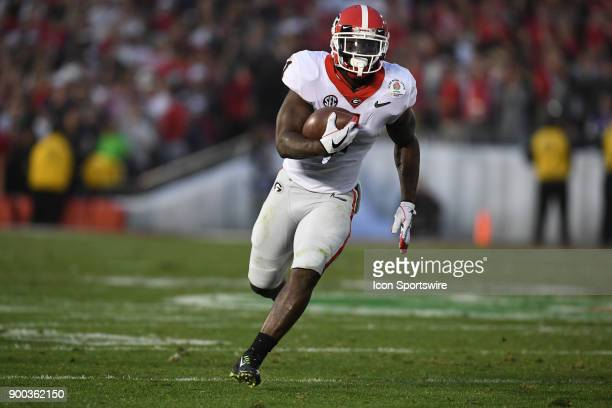 Sony Michel of the Georgia Bulldogs scores on a 38 Yd Run to tie the game 3131 during the 3rd quarter of the College Football Playoff Semifinal at...