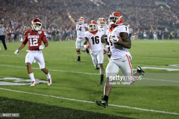 Sony Michel of the Georgia Bulldogs scores the winning touchdown in the 2018 College Football Playoff Semifinal Game against the Oklahoma Sooners at...