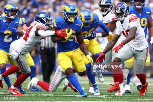 Sony Michel of the Los Angeles Rams in action against James Bradberry and Tae Crowder of the New York Giants during a game at MetLife Stadium on...