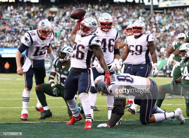 Sony Michel of the New England Patriots celebrates after scoring a touchdown against the New York Jetsduring their game at MetLife Stadium on...