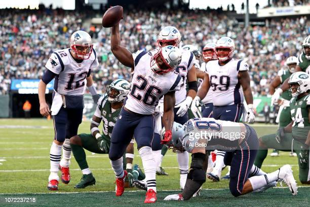 Sony Michel of the New England Patriots celebrates his fourth quarter one yard rushing touchdown against the New York Jets at MetLife Stadium on...