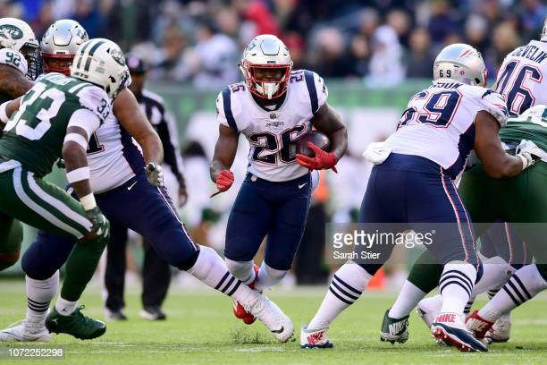 Sony Michel of the New England Patriots runs the ball against the New York Jets at MetLife Stadium on November 25 2018 in East Rutherford New Jersey